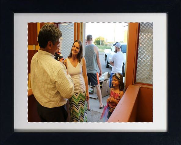 Chiropractor Brighton MI Melissa Osborn talking with guests